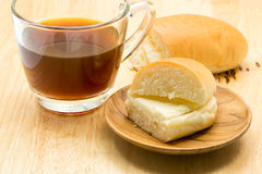 Hotdog bread filled with sweetened butter cream and a cup of cof Stock Image