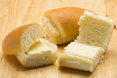 Hotdog bread filled with sweetened butter cream Stock Images