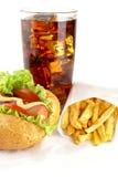 Hotdog com batatas fritas no guardanapo com vidro da cola Fotografia de Stock