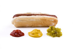 Hotdog with Condiments Royalty Free Stock Photography