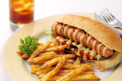 Hotdog deluxe. Grand portion of hotdog, fries and soda Stock Image
