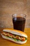 Hotdog en kola Stock Foto
