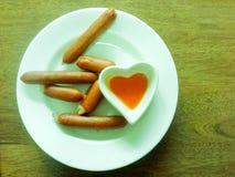Hotdog im Teller Stockfoto
