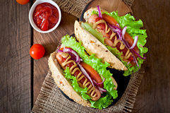 Hotdog with ketchup, mustard, lettuce and vegetables Royalty Free Stock Image