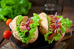 Hotdog with ketchup, mustard, lettuce and vegetables Royalty Free Stock Photo