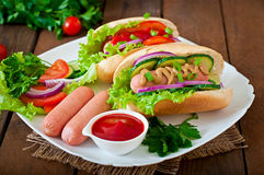 Hotdog with ketchup, mustard, lettuce and vegetables Royalty Free Stock Photography