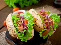 Hotdog with ketchup mustard and lettuce Stock Photography