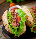 Hotdog with ketchup mustard and lettuce Royalty Free Stock Images