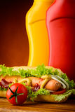 Hotdog with ketchup, mustard and vegetables Royalty Free Stock Photos