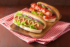 Hotdog with ketchup mustard and vegetables Stock Images
