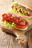 Hotdog with ketchup mustard and vegetables Royalty Free Stock Photos