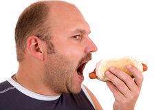 Hotdog lover. Mature man opening his mouth to take a bite of a hotdog Stock Images