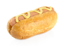 Hotdog with mustard isolated on white Stock Image