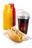 Hotdog with mustard and ketchup in the tray with cola on white Royalty Free Stock Photos