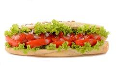 Hotdog op wit wordt geïsoleerd dat Stock Foto