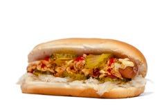 Hotdog/varmkorv Sida-sikt på vit Fotografering för Bildbyråer
