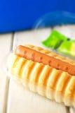 Hotdog. On wood white background royalty free stock photography