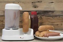 Hotdogmachine, met worsten Royalty-vrije Stock Foto