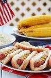Hotdogs e pratos laterais Fotos de Stock Royalty Free