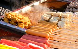 hotdogs and fish balls in wooden sticks royalty free stock photography