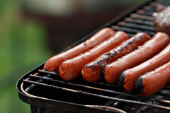 Hotdogs on grill Royalty Free Stock Images