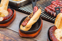 Hotdogs with grilled sausages Stock Images