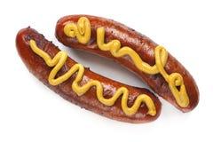 Hotdogs met Mosterd Royalty-vrije Stock Afbeeldingen