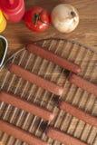 Hotdogs na metalu grillu Zdjęcie Royalty Free