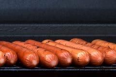 Hotdogs op de grill Stock Foto's