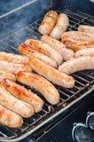 Hotdogs ou bratwurst grelhada Fotografia de Stock Royalty Free