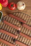 Hotdogs på metallgaller Royaltyfri Foto