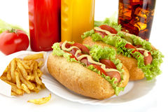 Hotdogs on plate with cola and french fries on white Stock Images