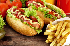 Hotdogs on plate with cola on wooden desk Stock Images