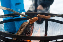 Hotdogs Roasting on an Open Fire. Hot Dogs and Marshmallows roasting on an open fires in the winter Stock Photos