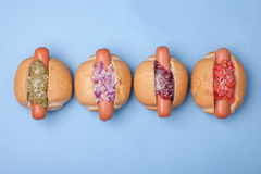 Hotdogs set isolated on blue background, top view Stock Photo