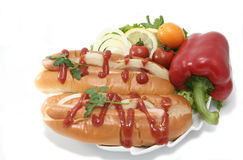Hotdogs with vegetables. Food on white background Stock Image