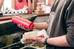Hotdogverkoper stock afbeelding