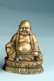 Hotei que ríe la estatua del latón de Buddha Imagenes de archivo