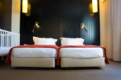 Hotel. Family accommodation with twin beds and cradle Royalty Free Stock Photography