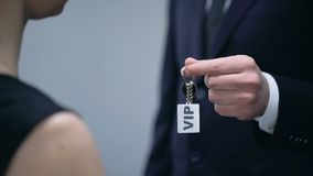 Hotel administrator giving woman keys to VIP apartment, luxury hotel service. Stock footage stock video footage