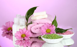 Hotel amenities kit. On pink background stock image