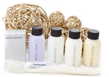 Hotel amenities kit and decorative wicker balls. Royalty Free Stock Image
