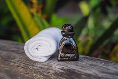 Hotel amenities kit spa, soap, shampoo, towels stock photo