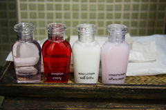 Hotel amenities kit spa, soap and shampoo in vintage bathroom Stock Photo