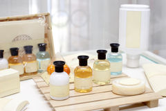 Hotel amenities. Set consisting in shampoo, shower gel, soap Stock Photo