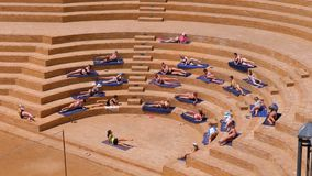 Hotel Animation in Egypt on the Beach Holds Gymnastics Exercises for Tourists. EGYPT, SHARM EL SHEIKH, APRIL 8, 2019: Hotel Animation in Egypt on the Beach Holds stock footage