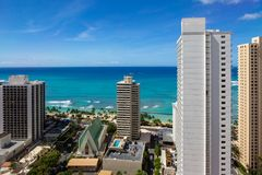 The hotel architecture with the iconic Waikiki beach in the back. Ground Honolulu Hawaii on 5th of October 2018 royalty free stock image