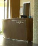 Hotel-Aufnahme-Schreibtisch Lizenzfreies Stockbild