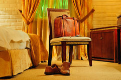 Hotel background. With a chair, a suitcase and key Stock Photo