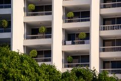 Hotel balconies decorated with small trees. Very good place for resting during afternoon high temperature stock images